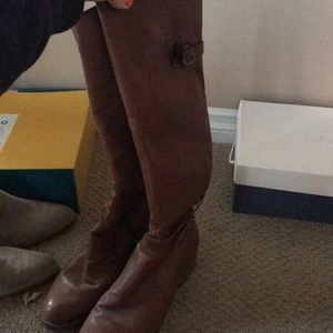 Tall knee high leather brown boots